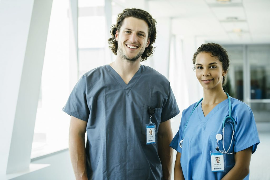 An Elite Specialty Staffing travel nurse, and a contract nurse at their jobs in a hospital