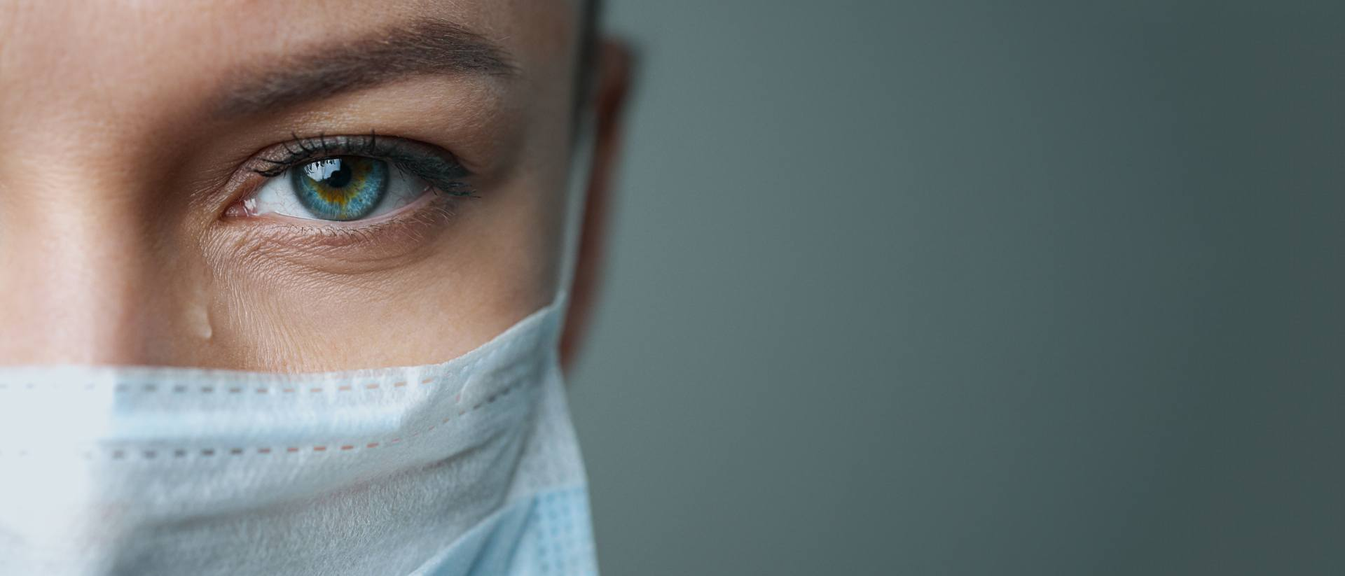 up close picture of travel nurse wearing mask